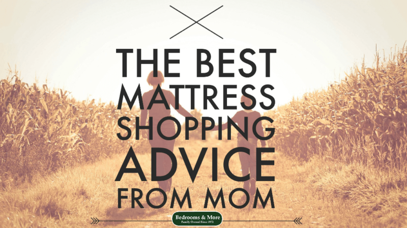 Mom & daughter walking together in field of wheat discussing mattress shopping advice