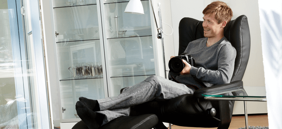 Stressless Wing Recliner with Man and Camera